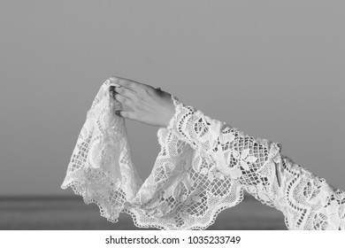 hands on the background of the sea in lace fabric