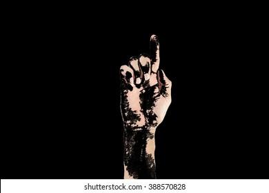 hands on black background