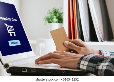 hands on computer keyboard with credit card, online shopping