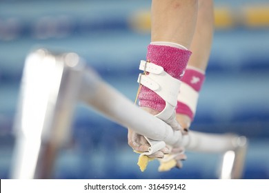 Hands on the gymnastic bars
