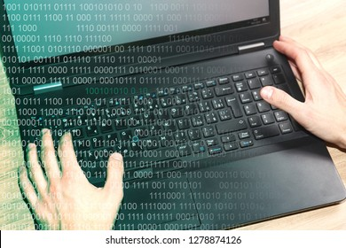 Hands on laptop keyboard. Hacker concept with binary code. Data leakage. Cyber attack. Software programmer.