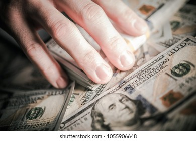 Hands on the Money. Corruption Concept. Caucasian Male Hands Grabbing American One Hundred Dollar Banknotes.