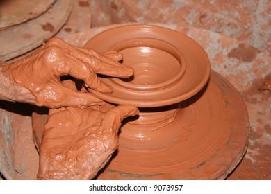 hands on a pot wheel