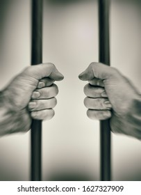 Hands on prison bars, first person view with motion blur