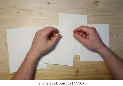 hands on sheets of paper on the table
