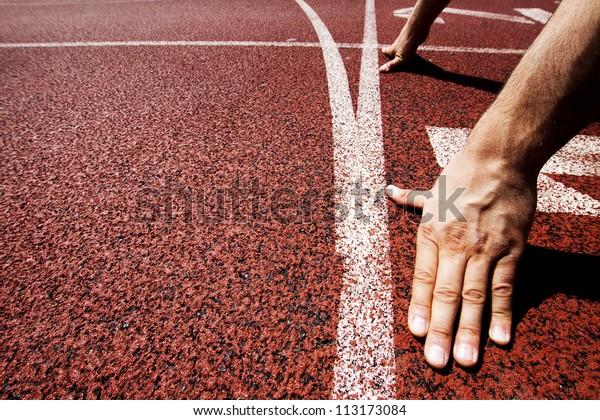 Hands on starting line