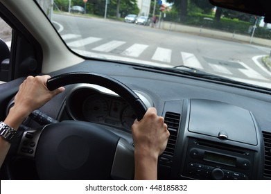 hands on the steering wheel in the street car
