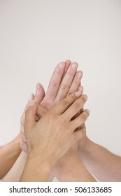 hands on top of one another each other