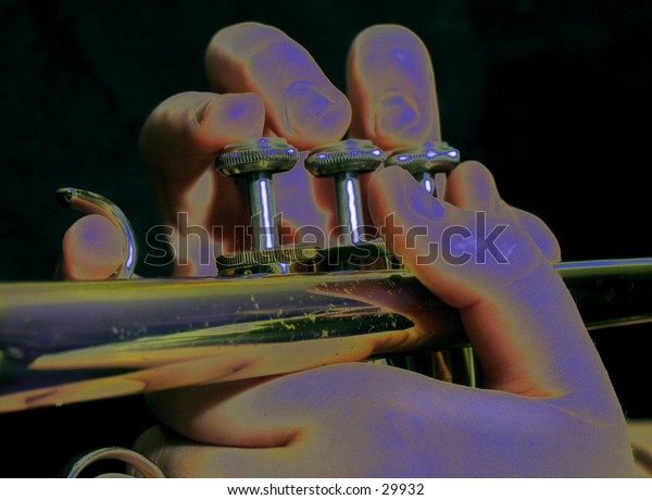 Hands on a trumpet with neon blue lighting