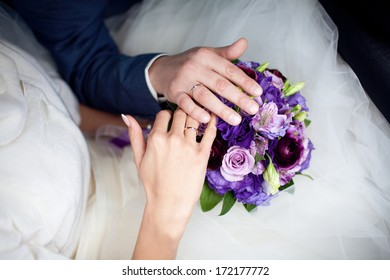 hands on the wedding bouquet