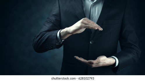 Hands open businessman. Your objects are here.
