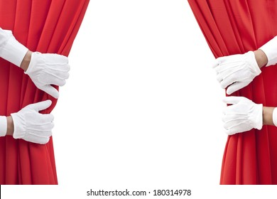 hands opening red curtain on white.