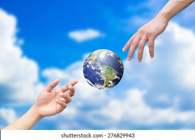 hands outstretched and reaching the world for heal together for save and helping the earth concept,Elements of this image furnished by NASA