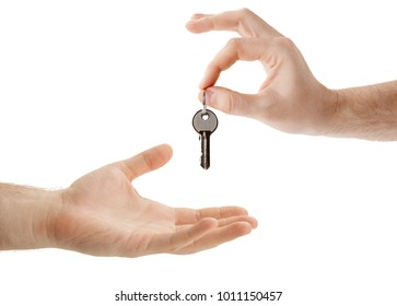 hands over the keys to the apartment from hand to hand closeup isolated
