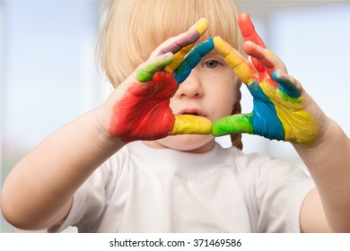 Hands painted in colorful paints.
