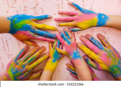 Hands painted in different colors. Concept of love, friendship, happiness in family