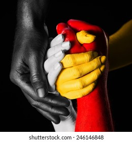 hands painted in different colors. multiracial concept. every color represent one skin race