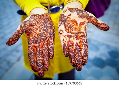 Hands painted with henna close up