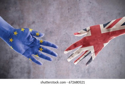 Hands painted with UK and European flag reaching out for a brexit handshake