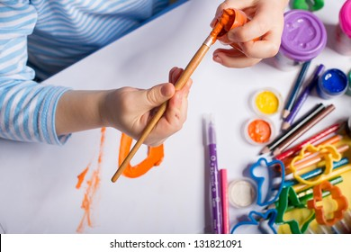 Hands of painting little boy and the table for creativity