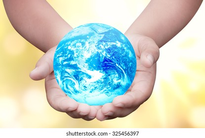 Hands palm up take care of blue global earth over blur background Think Earth concept  for poster advertising magazine or design Elements of this image furnished by NASA
