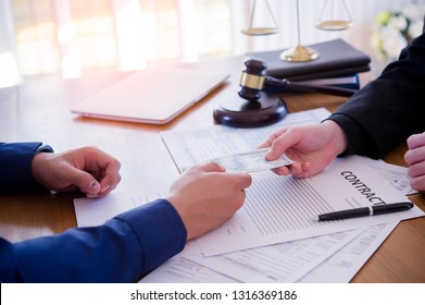 Hands passing money under table corruption bribery, businessman sealing the deal and receiving a bribe money.