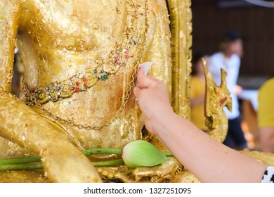 Hands are paste gold plates buddha images with lotus flowers on hands.