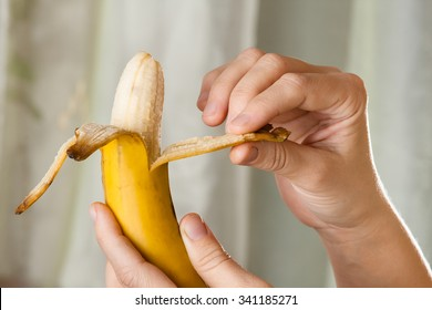 hands peeling a banana