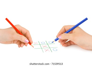Hands with pencils and game isolated on white background