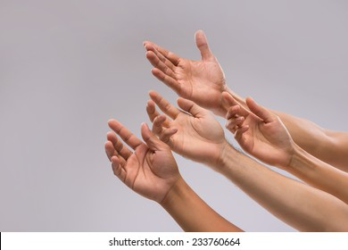 Hands of people begging for help