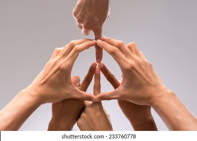 Hands of people forming a symbol of peace - Shutterstock ID 233760778