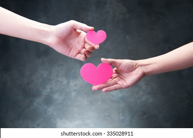 The hands of people who have a red heart