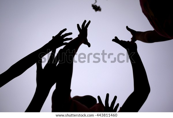 The hands of people who are pursuing, Game of scrimmage Some objects thrown into the air