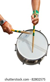 The hands of a percussionist playing his drum isolated in white