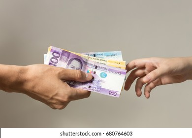 Hands and philippines peso