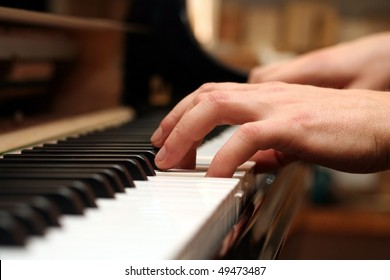 the hands of a piano playing guy in a sensitive mood.