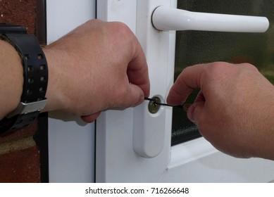 hands picking a door lock