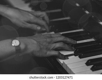 Hands play the piano.