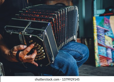 Hands playing an accordeon in La Boca, a traditional neighborhood of Buenos Aires