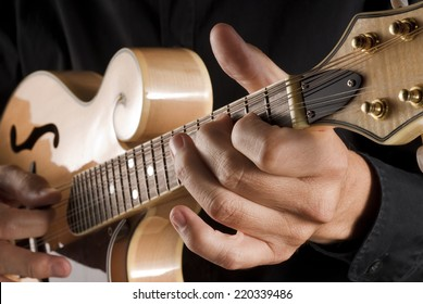 hands playing a classic bluegrass mandolin