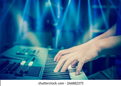 hands playing the keyboard or piano, focus middle finger