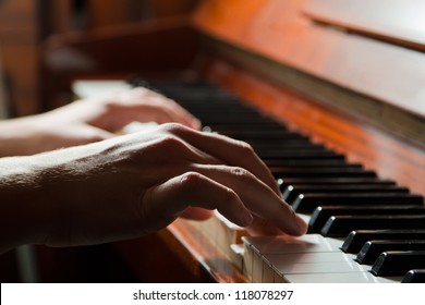Hands playing the piano (close-up)