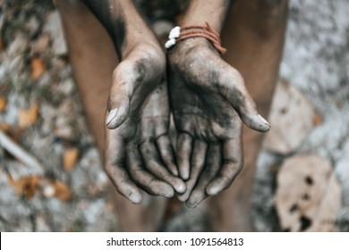 hands poor child begging you for help sitting at dirty slum. concept for poverty or hunger people, Human Rights,background text.