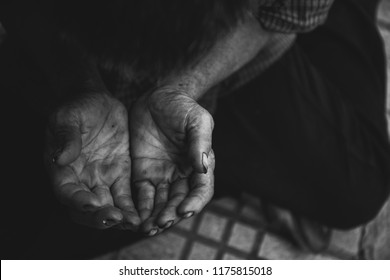 hands poor old man or beggar begging you for help sitting at dirty slum.concept for poverty or hunger people,human Rights,donate and charity for underprivileged elderly people in third world