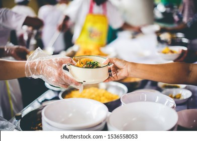 The Hands of the Poor Receive Charity Food Service from Volunteers :  The Concept of Poverty and Hungry