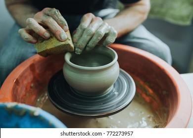 Hands of a potter. Potter making ceramic pot on the pottery wheel