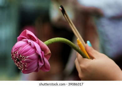 hands praying holding lotus and incense, bagkok thailand