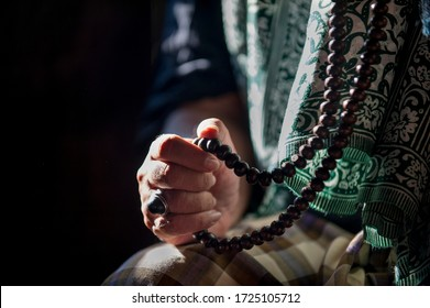 Hands praying,Crop hand of muslim man holding rosary or tasbih. shallow dept of field.