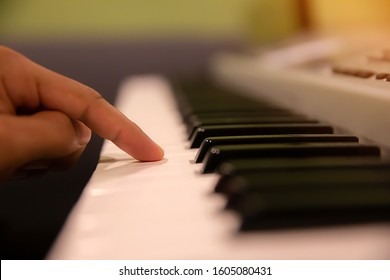 Hands pressed down on the piano keyboard.
