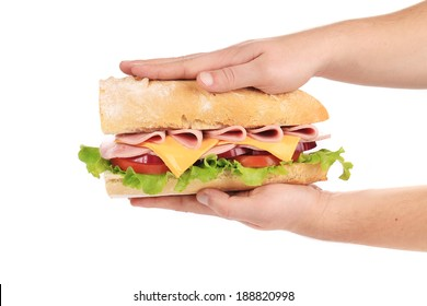 Hands pressing tasty sandwich. Isolated on a white background.